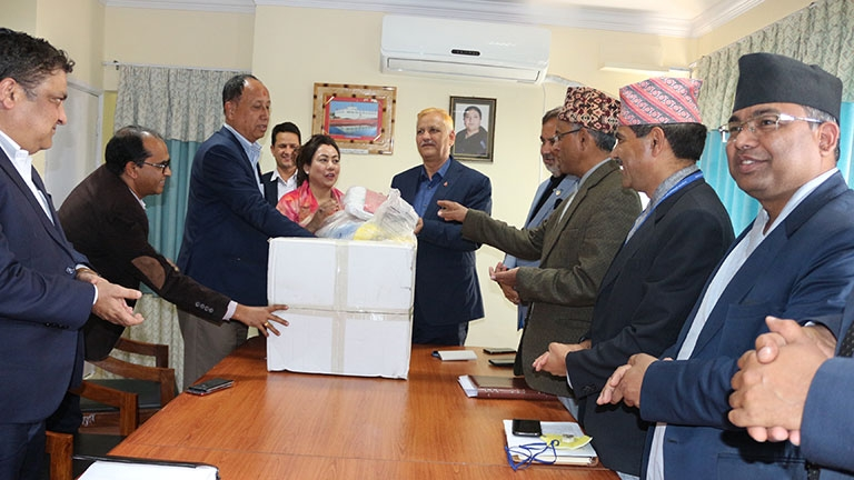 Handover Personal Protective Equipment to Hon\'ble Minister for Health & Population
